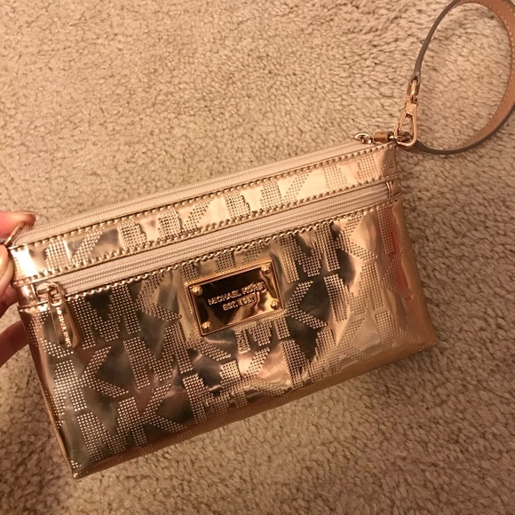 7e2973a52c53 Michael Kors wristlet Rose Gold mirror metallic. M_5ab4bb44f9e5019d7fa7e0b5